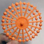 Breakaway Orange Beads on a Wheel